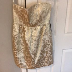 Strapless gold brocade dress with pockets